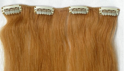 Stripper clip on human hair extensions